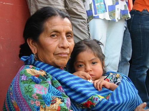 """""""Mayan Woman with Child in Antigua, Guatemala"""" by Timoluege is licensed under CC BY-NC 2.0"""